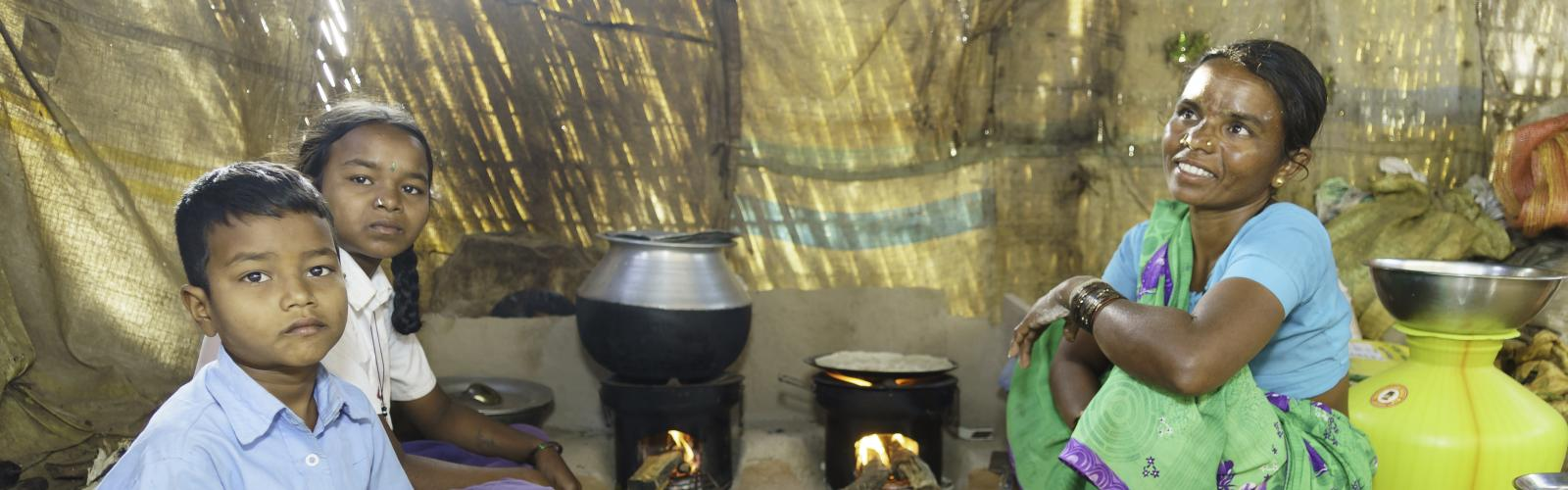 Woman and children with cookstove in India
