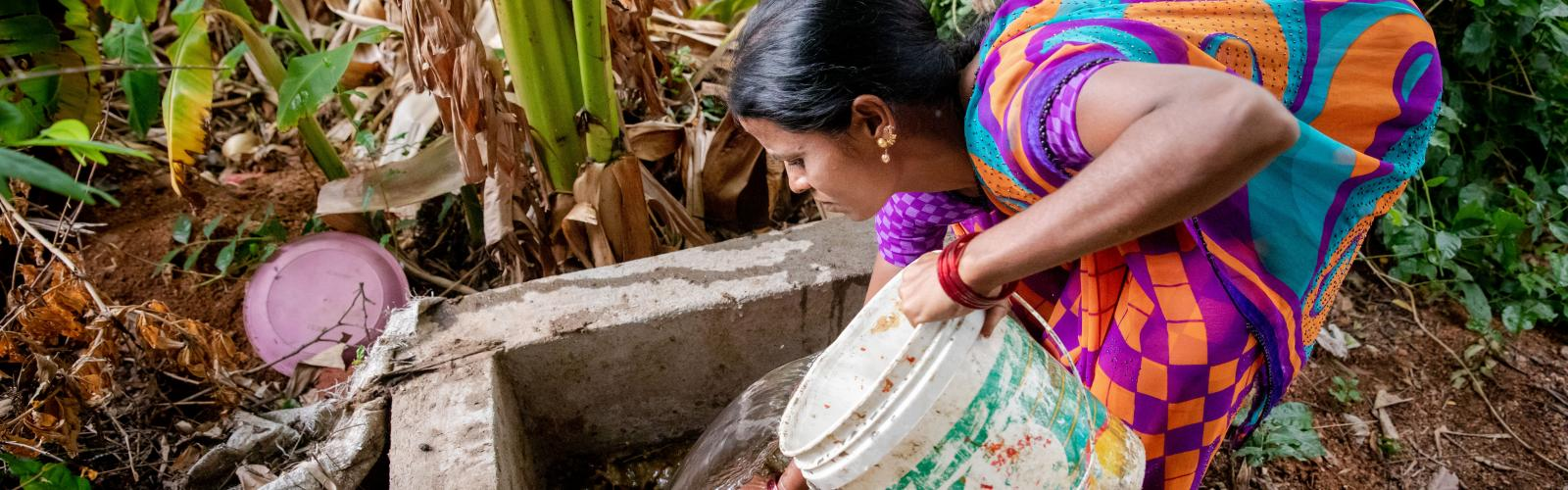 Woman working with biogas installation
